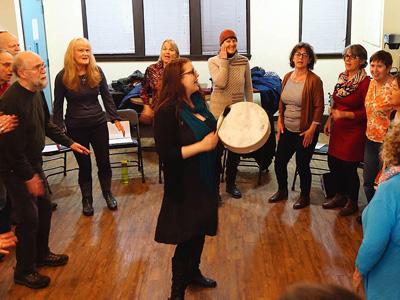 Heidi leading choir